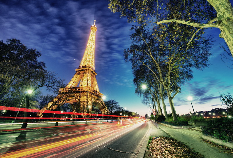 PARIS - DEC 1: Eiffel Tower shows its wonderful lights at sunset